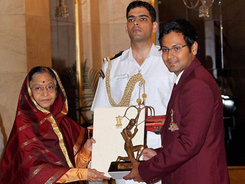 President Pratibha Patil presents Arjuna Award to archery to Rahul Banerjee at Sports and Adventure Awards 2011 function at the Rastrapati Bhavan in New Delhi.