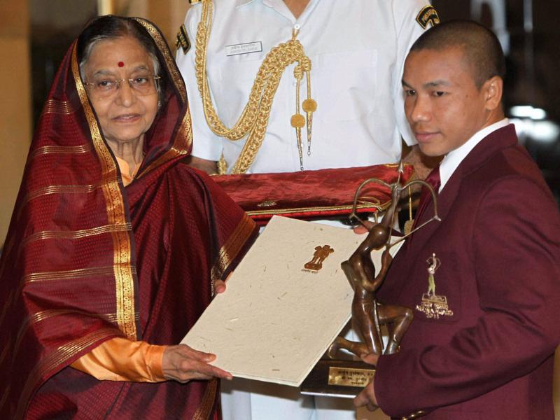 President Pratibha Patil presents Arjuna Award to boxer Suranjoy Singh at Sports and Adventure Awards 2011 function at the Rastrapati Bhavan in New Delhi.