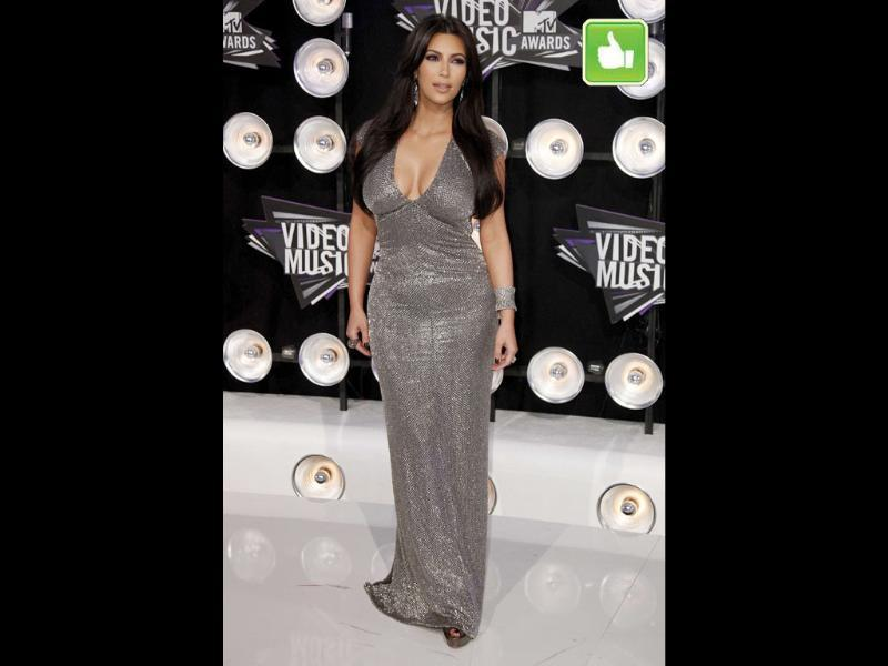 Kim Kardashian sticks to figure-hugging, silver number that hugs the curves at all the right places.