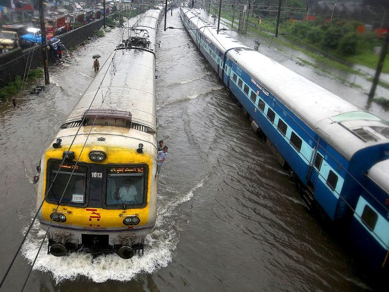 Railway tracks flooded by rain water. Heavy rain and disrupted rain traffic at Kurla in Mumbai.