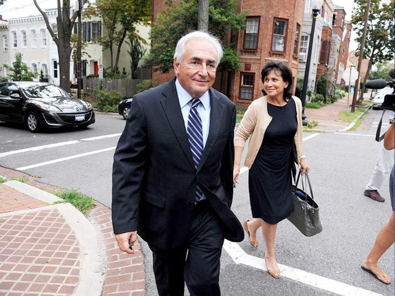 Dominique Strauss-Kahn and his wife Anne Sinclair return to their residence in Georgetown after paying a visit to the IMF headquarters in Washington.