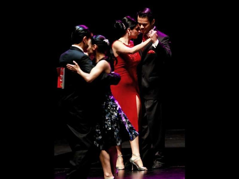 Brian Nguyen and Yuliana Basmajyan of San Francisco, California, compete against other couples during the 2011 Tango World Championship Salon category in Buenos Aires, Argentina.