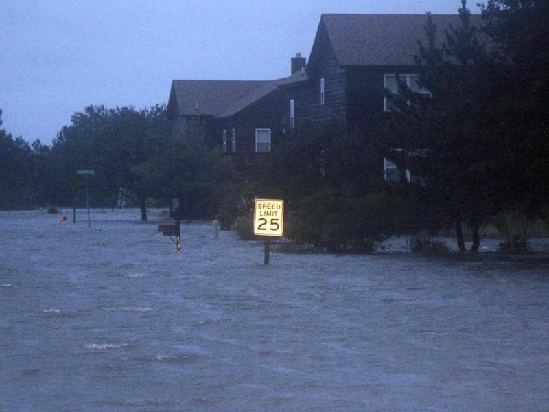 Floodwaters rise at dusk from the Albemarle Sound on the Outer Banks in Nags Head, NC.