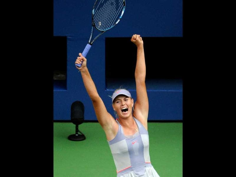 Maria Sharapova of Russia celebrates match point against Heather Watson of Great Britian during Day One of the 2011 US Open at the USTA Billie Jean King National Tennis Center in the Flushing neighbourhood of the Queens borough of New York City.