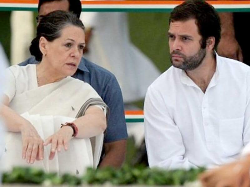 In this May 21, 2011 file photo, Congress chief Sonia Gandhi talks to son Rahul Gandhi during a memorial ceremony for husband Rajiv Gandhi on the former prime minister's 20th death anniversary in New Delhi.