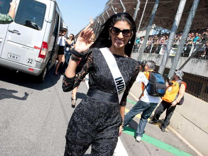 Miss Universe India 2011 Vasuki Sunkavalli waves as she visits an auto race at GT Brasil raceway in Sao Paulo. (Reuters/Richard D. Salyer/Miss Universe Organization, L.P. LLLP/Handout)