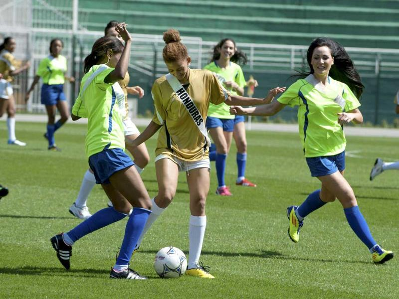 Miss Universe Honduras 2011 Keilyn Gomez (C) fights for the ball with Miss Universe St. Lucia 2011 Joy-Ann Biscette (L) and Miss Universe New Zealand 2011 Priyani Puketapu (R) during a soccer match at Pacaembu Stadium in Sao Paulo.