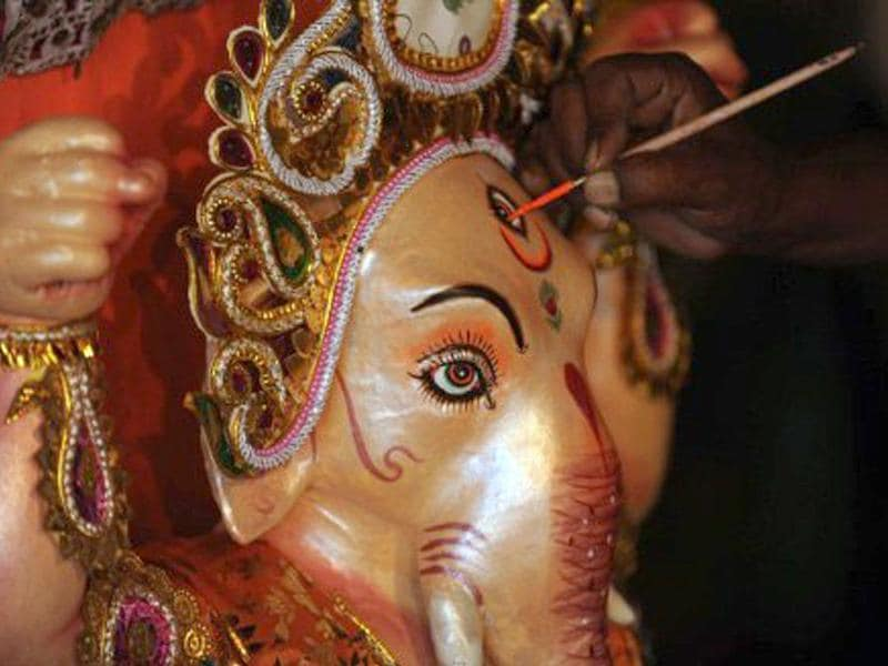 An artist gives final touches to an idol of Ganesh on the eve of the 12 day festival.