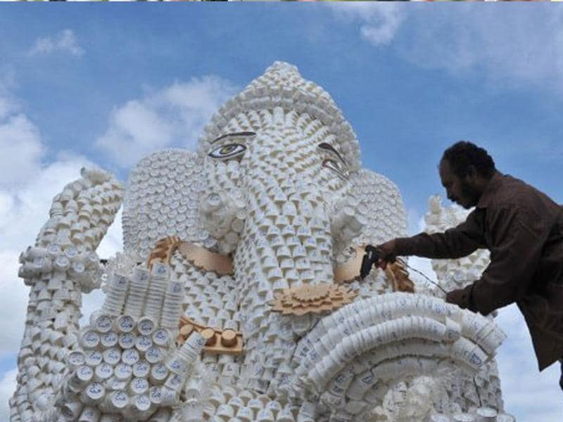 An artist works on a Ganesh idol made out of 30,000 paper cups in Hyderabad