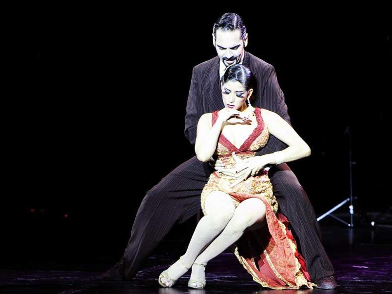 Venezuelan John Erban and Clarissa Sanchez, second place in the Salon Tango competition, perform to finish in fifth place in the Stage Tango competition at the 9th Tango Dance World Championship in Buenos Aires.