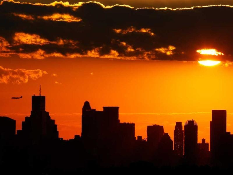 The sun sets over Manhattan during Day Two of the 2011 US Open at the USTA Billie Jean King National Tennis Center in the Flushing neighborhood of the Queens borough of New York City.