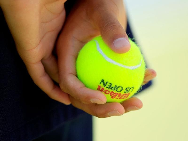 A ball person holds a tennis ball during Day Two of the 2011 US Open at the USTA Billie Jean King National Tennis Center in the Flushing neighborhood of the Queens borough of New York City.