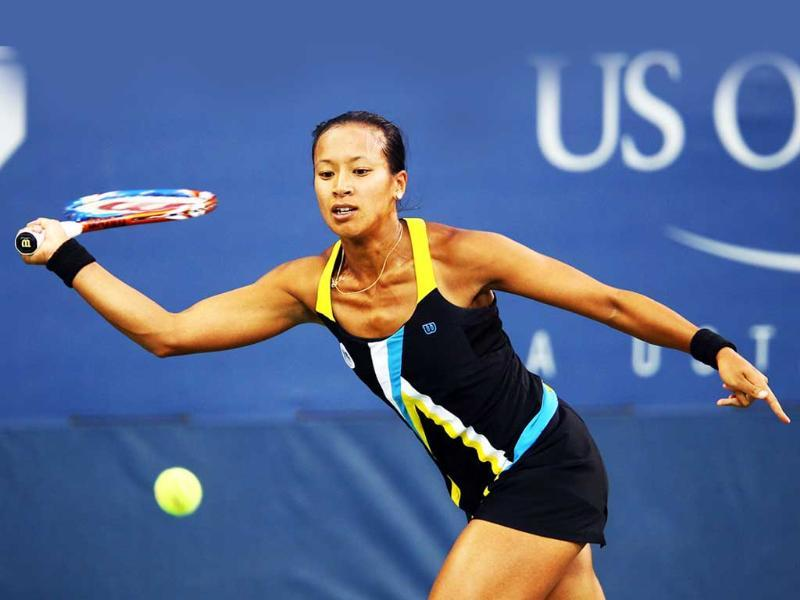 Anne Keothavong of Great Britain returns a shot against Chanelle Scheepers of South Africa during Day Two of the 2011 US Open at the USTA Billie Jean King National Tennis Center in New York City.