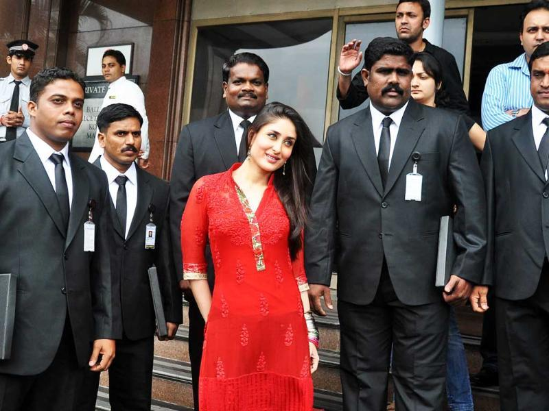 Indian Bollywood actress Kareena Kapoor (C) poses with celebrity bobdyguards during the promotion of her new Hindi film 'Bodyguards' in Mumbai.