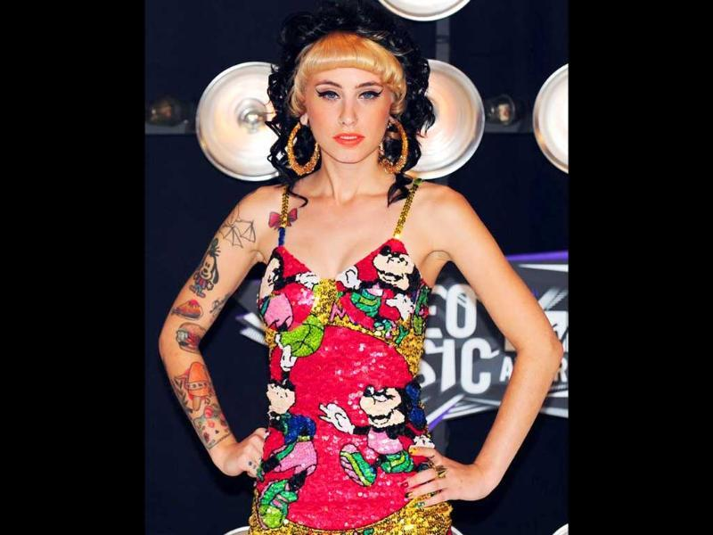 Newcomer Kreayshawn pulls off Amy Winehouse-inspired hair and makeup pretty well. Photo by AFP/Frederic J. Brown