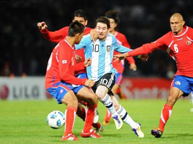 Argentine forward Lionel Messi (C) is marked by Costa Rican defenders Oscar Duarte (L), Johnny Acosta (2-L) and Heiner Mora (R) during a 2011 Copa America Group A first round football match held at the Mario Kempes stadium in Cordoba, 770 Km northwest of Buenos Aires.