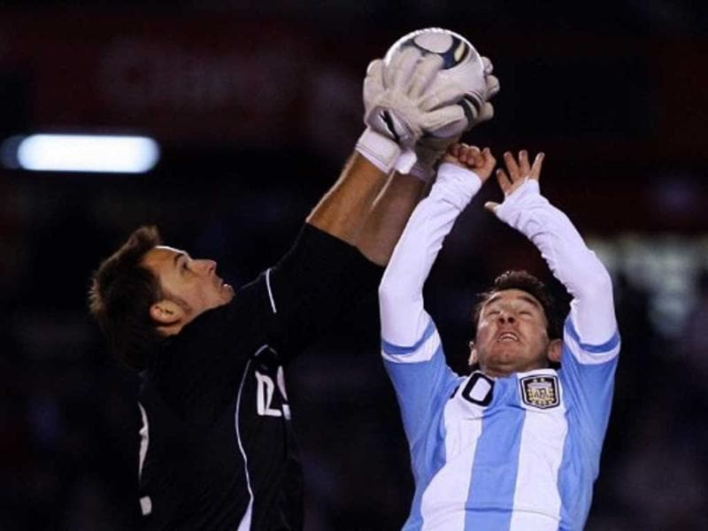 Argentina's forward Lionel Messi (R) vies for the ball with Albania's goalkeeper Isli Hidi during a friendly football match at the Monumental stadium in Buenos Aires on June 20, 2011. Argentina won 4-0.