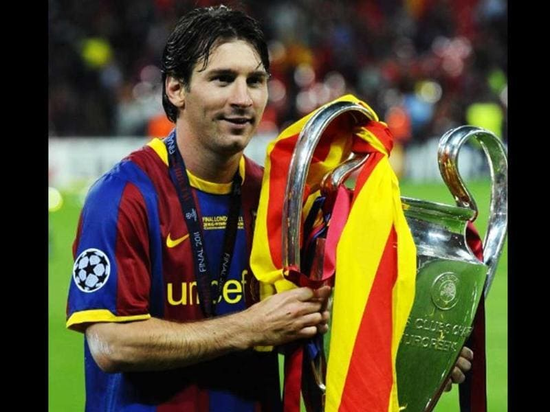 Barcelona's Argentinian forward Lionel Messi celebrates with the trophy at the end of the UEFA Champions League final football match FC Barcelona vs. Manchester United, on May 28, 2011 at Wembley stadium in London.Barcelona won 3 to 1.