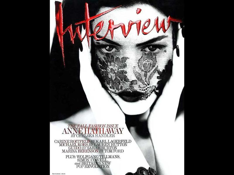 Interview: Anne HathawayDark lips, monochome theme and piercing eyes from behind a veil, it doesn't get any better.