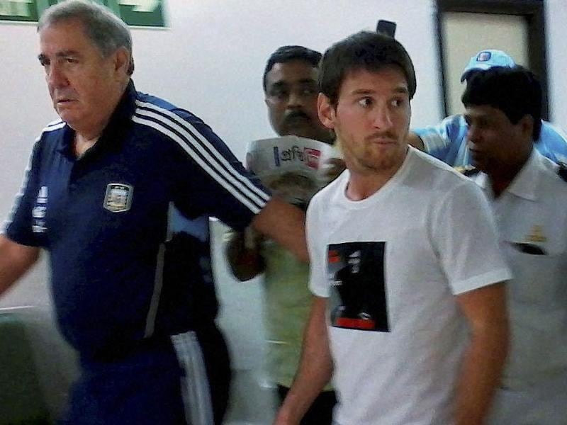 Argentina footballer Lionel Messi (R) arrives at NSCBI Airport in Kolkata to play an exhibition match with Venezuela.