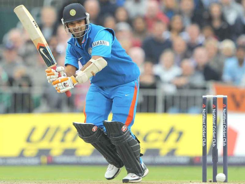 Ajinkya Rahane bats during the 20-20 cricket match between England and India at Old Trafford cricket ground in Manchester, north-west England.