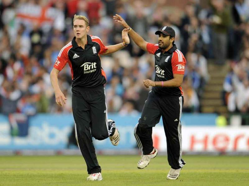 England's Stuart Broad and Ravi Bopara (R) celebrate the dismissal of India's Ajinkya Rahane during the Twenty20 international cricket match at Old Trafford cricket ground in Manchester.