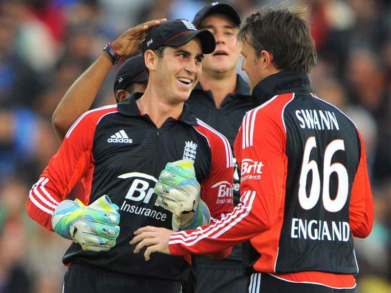 England's Craig Kieswetter (L) celebrates with England's Graeme Swann (R) after stumping India's Rohit Sharma during the 20-20 cricket match between England and India at the Old Trafford cricket ground in Manchester.