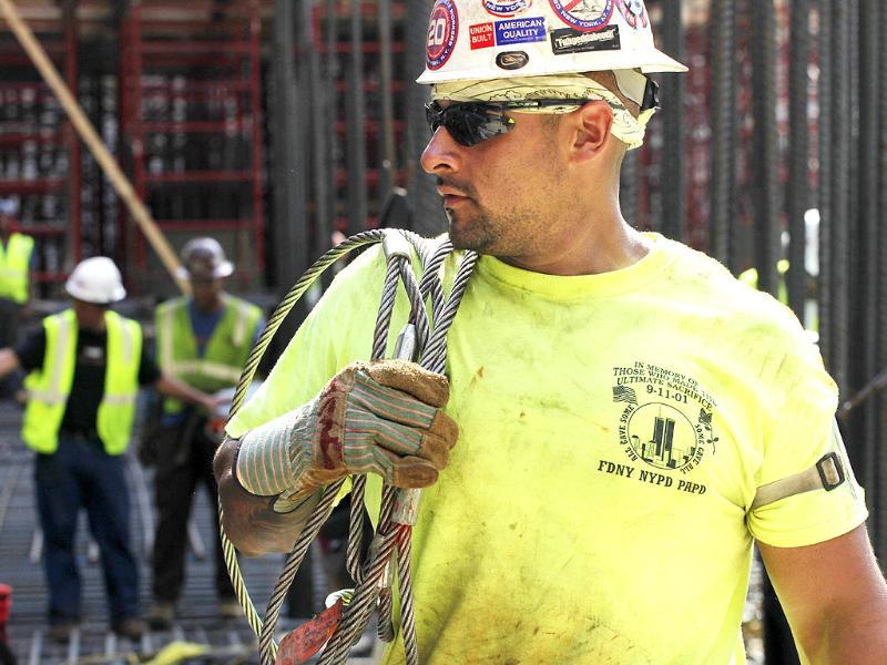 A construction worker carries steel cable at World Trade Center in New York. September 11, 2011 will mark the tenth anniversary of the terrorist attacks in the United States. He wears a t-shirt that commemorates those who lost their lives in the attacks.