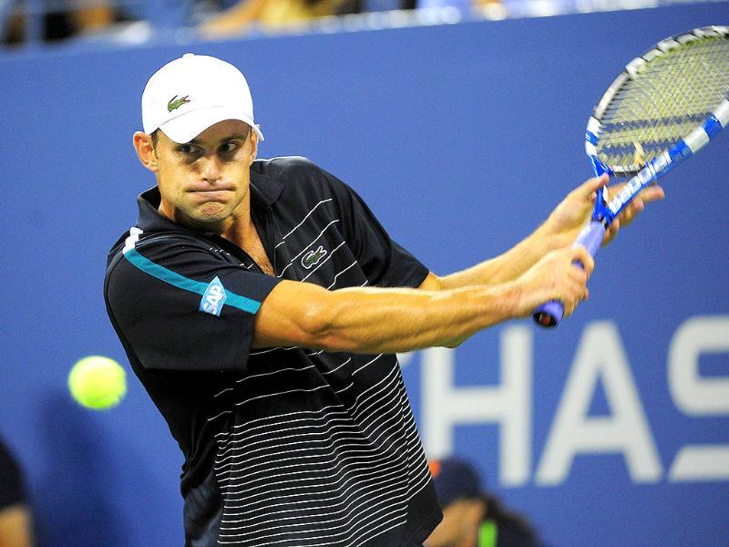 US tennis player Andy Roddick returns a shot to US Michael Russell during their Men's US Open 2011 match at the USTA Billie Jean King National Tennis Center in New York.