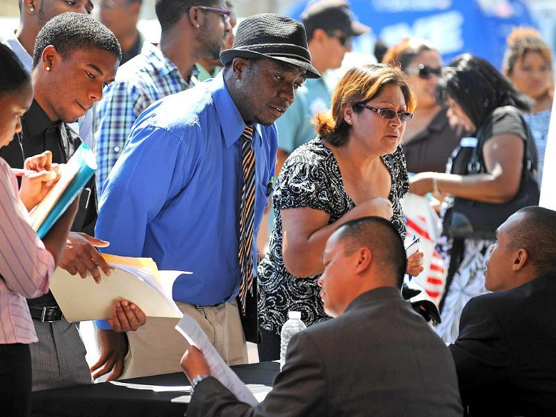 Job-seekers talk to employers during an outdoor job fair at the Crenshaw Christian Center in South Los Angeles.