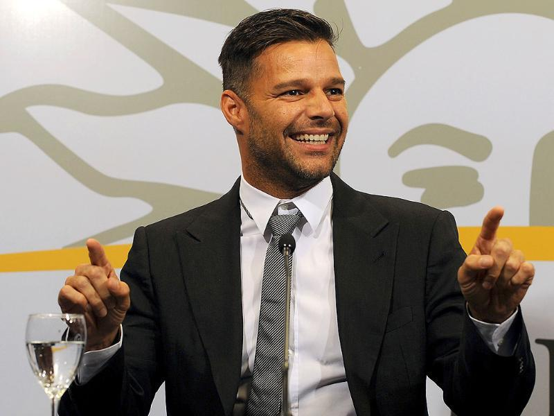 Puerto Rican singer Ricky Martin gestures during a press conference, after a meeting with Uruguayan President Jose Mujica (out of frame) at the Ejecutiva Tower in Montevideo.