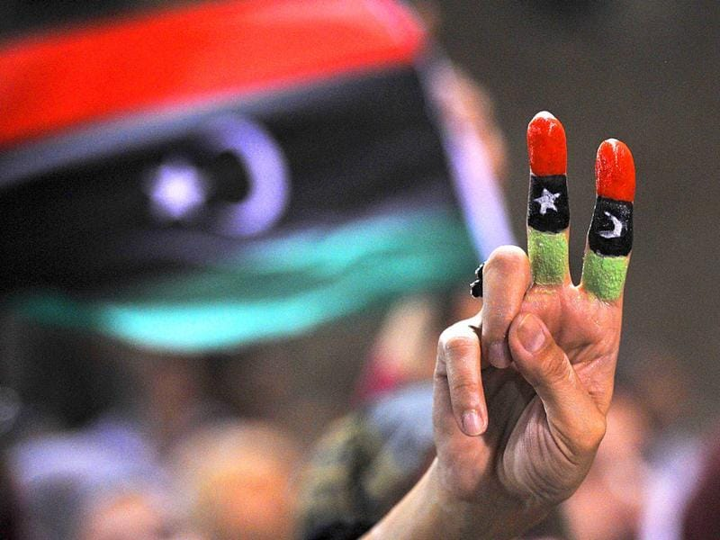 A woman with fingers painted in the colours of the Libyan flag celebrates in Martyrs Square in Tripoli. Thousands of Libyans gathered in the square to celebrate the success of rebel fighters against Colonel Gaddafi's forces and the beginning of the Muslim festival Eid.