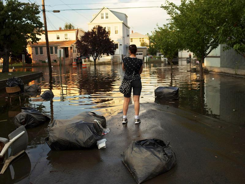 A woman looks out over a flooded street in Wallington, New Jersey. New Jersey was especially hard hit by Hurricane Irene with thousands of residents forced into shelters due to flooded homes and many more still without electricity as rivers and creeks overflowed in the aftermath of the storm.
