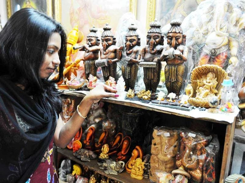 P Sanjana daughter of collector Pabsetti Shekhar holds an idol of Lord Ganesh from their home collection in Hyderabad during the festival 'Ganesh Chaturthi'.