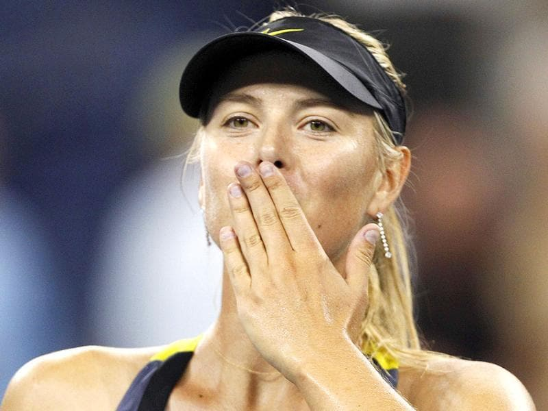 Maria Sharapova, of Russia, blows a kiss to the crowd after beating Anastasiya Yakimova, of Belarus, 6-1, 6-1 during the US Open tennis tournament in New York.