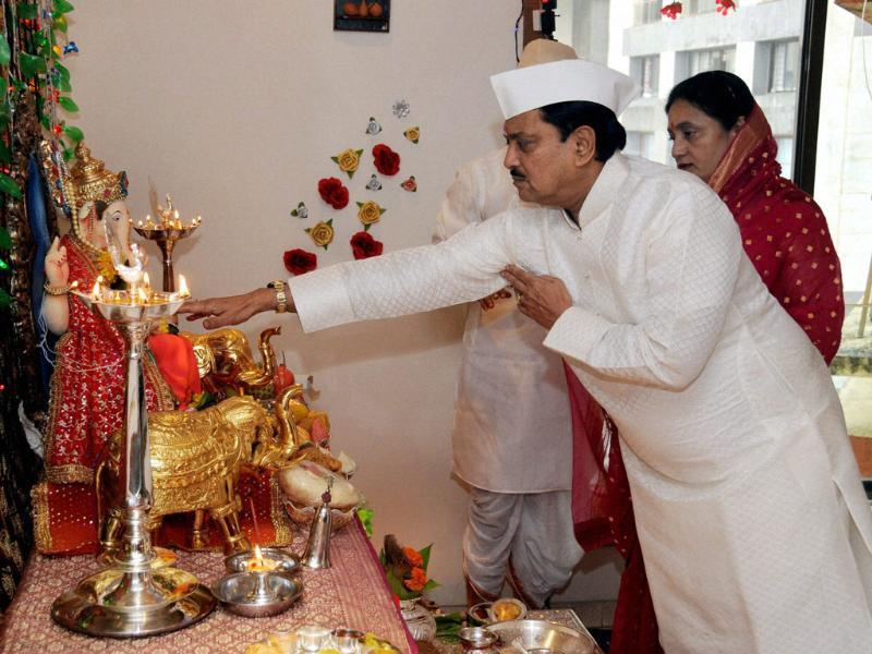 Union minister of science and technology Vilasrao Deshmukh (R) along with his wife Vashali worship Lord Ganesha at their residence on the occasion of Ganesh festival, in Mumbai.