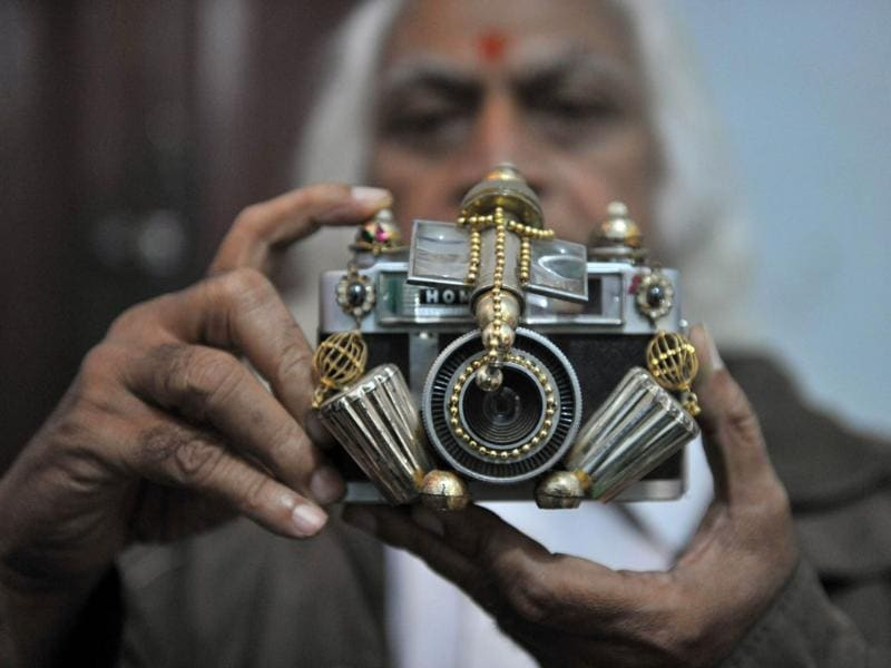 Doctor Amaravadi Prabhakar Chary shows an idol of Lord Ganesh in the form of a camera as showcased at an exhibition in Hyderabad on the ocassion of Ganesh Chaturthi.
