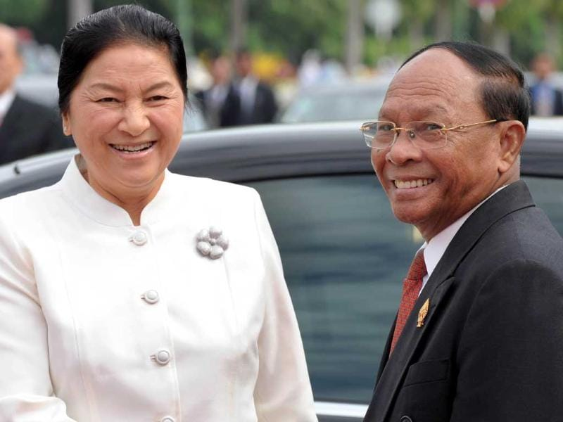 President of the Cambodian National Assembly and Honorary president of the Cambodian People's Party (CPP) Heng Samrin (R) and President of the Laos National Assembly Pany Yathotu (L) smile upon her arrival at the National Assembly building in Phnom Penh. Pany is here for a four-day official visit.