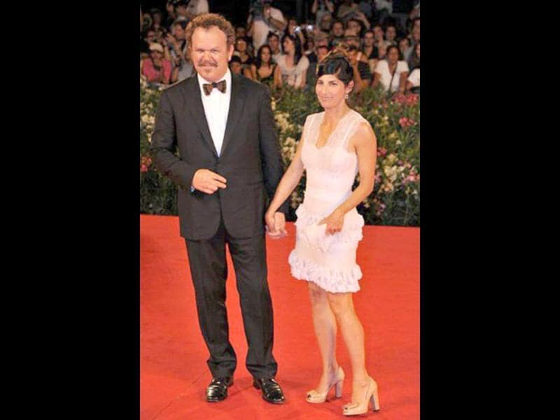 Actor John C. Reilly and his wife Alison arrive for the screening of Carnage at the 68th Venice Film Festival at Venice Lido.
