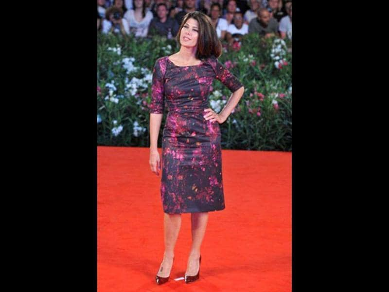 Actress Marisa Tomei, wearing a printed dress, arrives for the screening of Madonna's W.E. at Venice Lido.