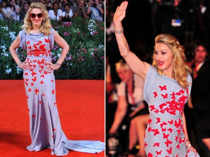 Madonna arrives for the screening of W.E. at Venice Lido, wearing a grey dress with embossed red butterflies and sunglasses! W.E. is director Madonna's out of competition presentation at the festival.