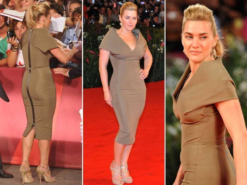 Later in the evening, Kate Winslet arrives for the screening of Carnage, wearing a daringly skintight Victoria Beckham dress. Carnage by director Roman Polanski is competing for the Golden Lion in the Venezia 68 category.