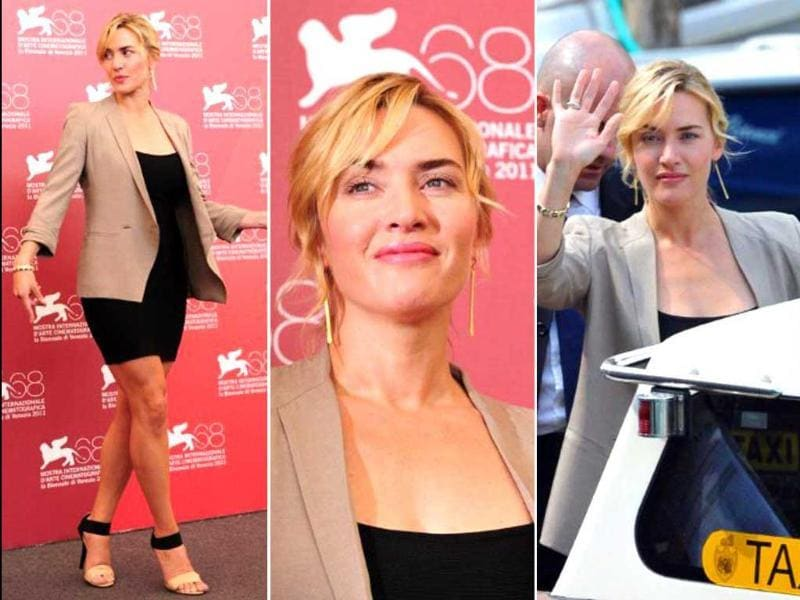 British actor Kate Winslet takes her place for the photocall of Carnage at the 68th Venice Film Festival, following which she boards a motoboat.