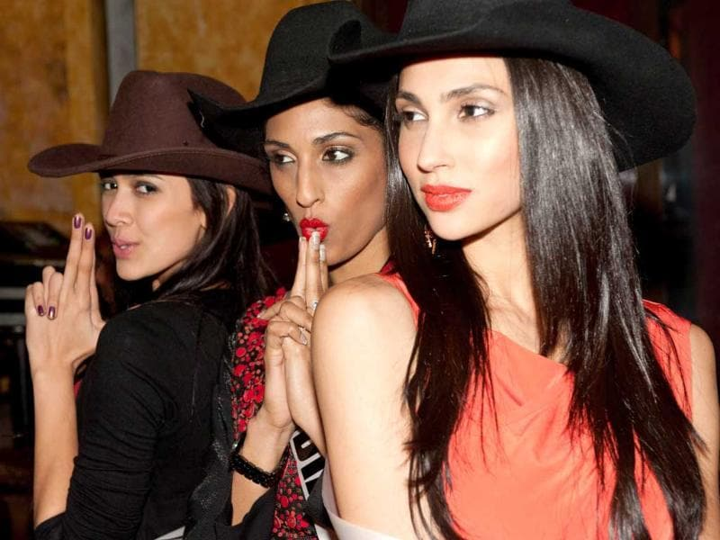 Miss Indonesia 2011, Nadine Alexandra; Miss India 2011, Vasuki Sunkavalli; and Miss Malaysia 2011, Deborah Henry; enjoy country dancing at Villa Country in Sao Paulo, Brazil.