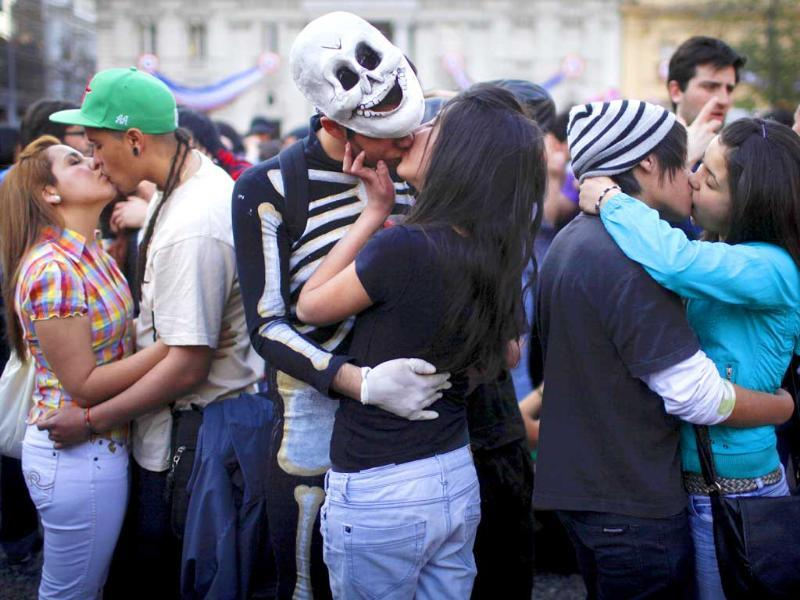 Chilean couples kiss during a demonstration demanding structural changes in the educational sector in downtown Santiago, Chile.