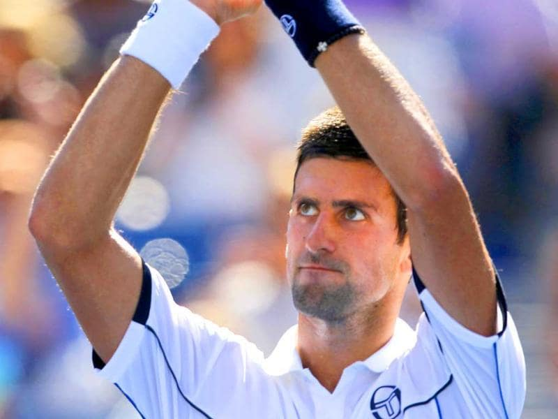 Novak Djokovic gestures to the crowd after his match with Conor Niland of Ireland in the first round of the US Open tennis tournament in New York.
