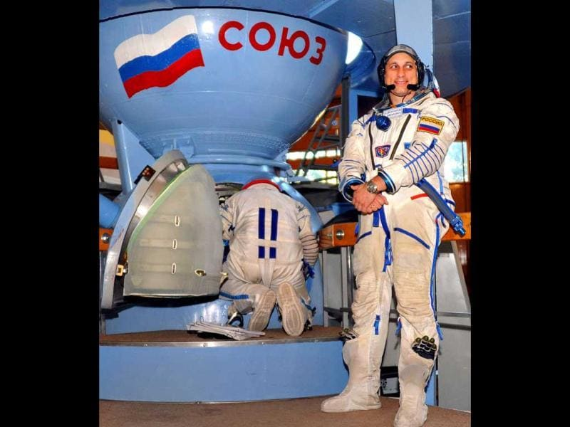 One of the members of the next expedition to the International Space Station, Russian cosmonaut Anton Shkaplerov, stands in front of a mock-up of the Soyuz space craft during his final preflight practical examination in Star City outside Moscow. Anton Shkaplerov together with Russian cosmonaut Anatoly Ivanishin and US astronaut Dan Burbank are to blast off for the ISS in a Russian-made Soyuz space craft on September 22.