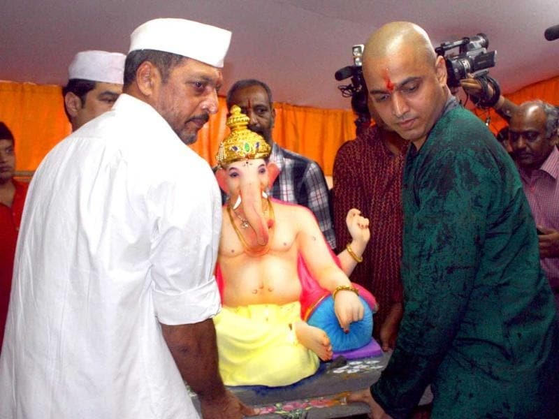 Nana Patekar with his son carrying an idol of Lord Ganesha for installation at their residence, on the occasion of Ganesh Utsav in Mumbai. (PTI)