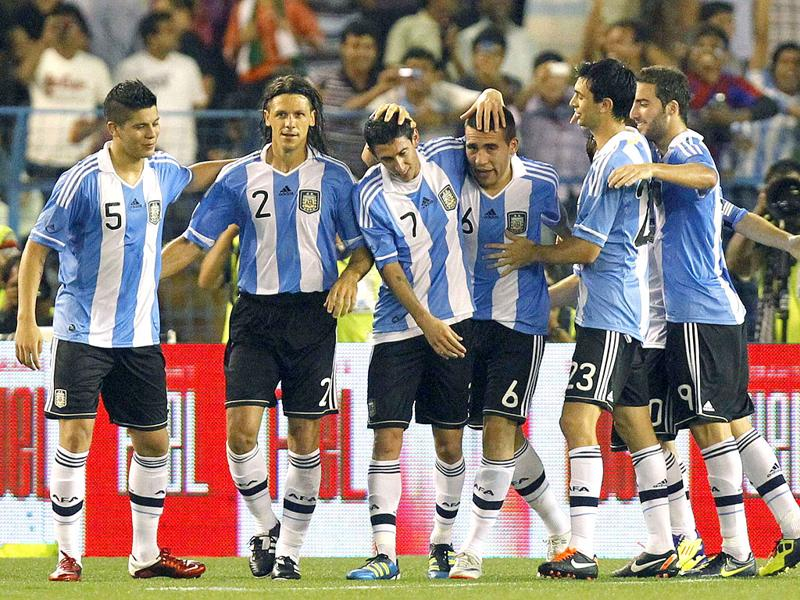 Argentina's Nicolas Otamendi (6) celebrates his goal with teammates during their international friendly soccer match against Venezuela in Kolkata.