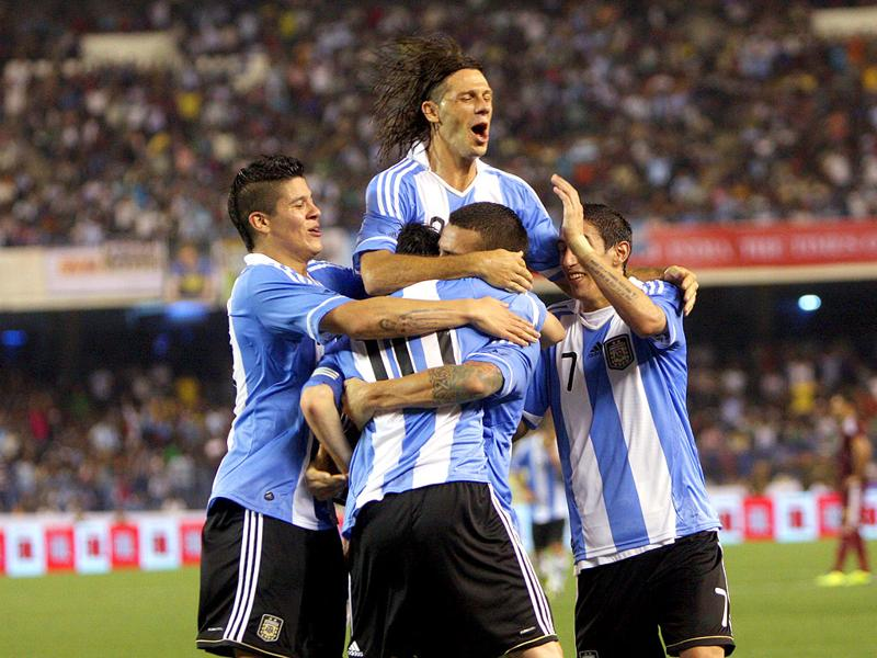 Argentina team celebrating their only goal against Venezuela in a friendly match at SL Stadium on Friday.